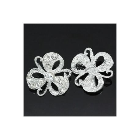 Metalinė saga su skaidriais kristalais, 25x23 mm